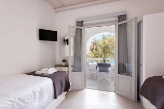 Two-bedroom apartment with sea view to kyma bedroom with view